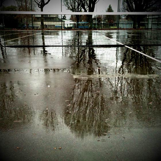 Grey's Park tennis park in the winter rain. iPhone photo, massaged with CameraBag app and saturation upped a little in Photoshop.